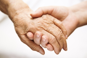 bigstock_Adult_Helping_Senior_In_Hospit_5315879